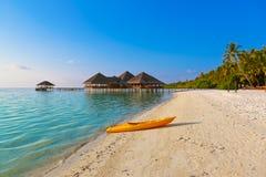 Boat on Maldives beach Stock Image