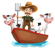 A boat with a man and two cows Royalty Free Stock Photography
