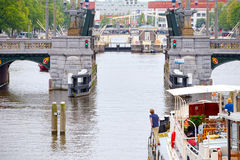 Boat maneuver through the canals of Amsterdam drawbridge Stock Photography