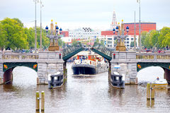 Boat maneuver through the canals of Amsterdam drawbridge Royalty Free Stock Image
