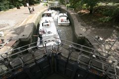 Boat manoeuver at lock Stock Images