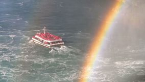 Boat with many tourists in mist with rainbow. Slow motion.Boat with many tourists in mist with rainbow Professional shot in HD resolution. 002. You can use it e stock video footage