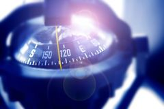 Boat marine compass in black blue light backlight Stock Photography