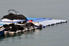 Boat and marine stuff on float platform in harbor. Shown as marine sport and entertainment or enjoy Stock Photo