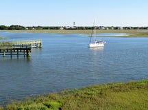 Sailboat floating on the marsh and wetlands along Shem Creek in Charleston, South Carolina royalty free stock image