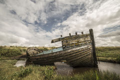 Boat on the marsh. A wide angle shot of a boat on the marsh Stock Photography