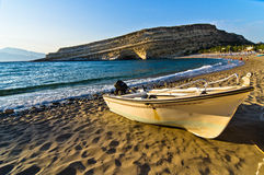 Boat on Matala beach, island of Crete Royalty Free Stock Images