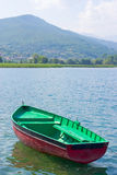Boat with mauntains in background Royalty Free Stock Image