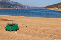Boat in Mavrovo lake, Macedonia, Balcans. Royalty Free Stock Photo