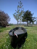 Boat in the meadow. Old boat sailing over spring grass and flowers in the meadow Stock Photography