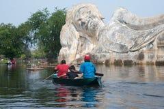 Boat in Mega flood on outdoot ancient lying Buddha. Stock Photo