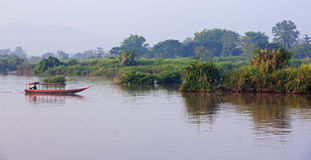 Boat on the Mekong River in the area of ​​Don Det Royalty Free Stock Photo
