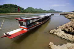 Boat on Mekong river, border crossing Stock Image