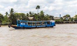 Boat on Mekong River, Vietnam Stock Photo