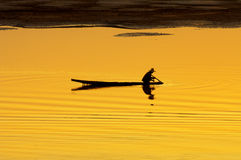 Boat on Mekong at Sunset. Silhouette of boatman at sunset on the Mekong river in Vientiane, Laos Stock Image