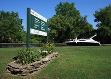 Boat with Merrickville Locks Sign Stock Photo