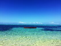 Boat in the Middle of Atoll Photo Royalty Free Stock Photo