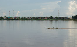 Boat in the middle of Khong river. The row boat in the middle of Khong river Royalty Free Stock Images