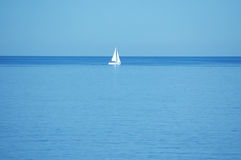 Boat in the middle of nowhere. Sea and the boat in the middle Royalty Free Stock Image