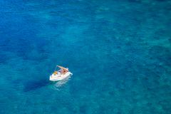 Boat In The Middle Of The Ocean Royalty Free Stock Photos