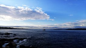 Boat in the Middle of the Sea. At Cape Elizabeth, Maine, USA Royalty Free Stock Image