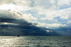 The boat in the mids of the ocean. The boat in the mids of the ocean when storm are coming Royalty Free Stock Images