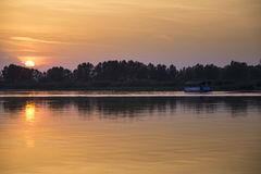 Boat on Mincio river. A boat  during the sunset on the river Mincio Stock Image