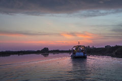 Boat on Mincio river. A boat  during the sunset on the river Mincio Royalty Free Stock Photos