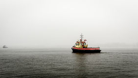 Boat in the mist. Alone Stock Photos