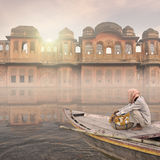 Boat in the mist. Boat in the mist in front an indian palace Stock Image