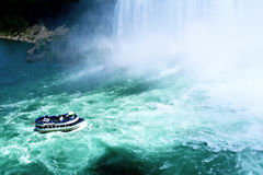 Boat in the mist of Niagara Falls. Boat in the beautiful mist of Niagara Falls, New York, USA Stock Photography