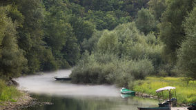 Boat in the mist,Rijeka Crnojevica in Montenegro Royalty Free Stock Photos