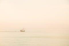Boat in the mist Stock Photo