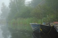 Boat on Misty Lake Royalty Free Stock Photography