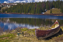 Boat by molas Lake. A boat sits off to the side of Molas Lake in Colorado's mighty San Juan Mountains near Silverton Royalty Free Stock Images