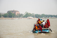 Boat with monks and the Mingun pagoda Stock Photos