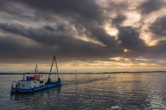 Boat in moody sky Royalty Free Stock Images