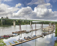 Boat Moorage Along Willamette River. In Oregon City with I-205 Freeway on George Abernethy Bridge Stock Photos