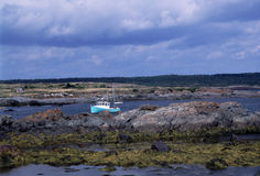 Boat Moored in Arichat Harbor, Nova Scotia Royalty Free Stock Image