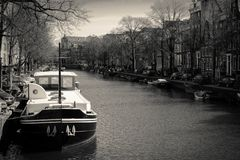 Boat moored in a canal in Amsterdam Netherlands. March 2015. Landscape format stock images