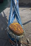 Boat moored with closeup of blue ropes in Portoferraio, Province of Livorno, on the island of Elba in the Tuscan Archipelago of It Stock Photography