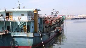 A ship moored at the dock. A boat moored at a dock, with a slow motion stock footage