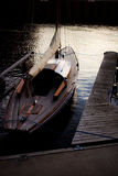 Boat moored in Gdansk. Oldshool, wooden boat in Gdansk. Photo was taken before storm in the evening Stock Images