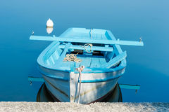 A boat moored in the harbor in the morning, Croatia. Stock Image