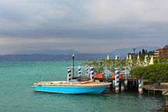 Boat moored on Lake Garda in Sirmione, Italy. Stock Photos