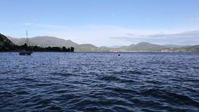 Boat moored on Lake Maggiore. In Cannero Riviera, Piedmont area stock video footage