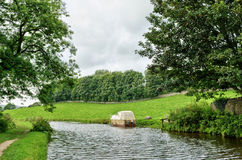 Boat moored on the Lancaster Canal, England Stock Photo