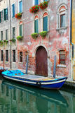 Boat moored in a narrow canal in Venice, Italy Stock Image