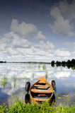 Boat moored rubber tires cloud reflection on water Stock Image