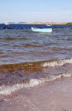 Boat moored in sea off beach Royalty Free Stock Photography